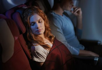 Qantas reshapes long-haul flying - a passenger sleeps happily